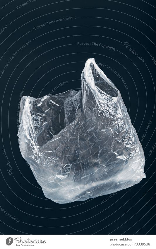 White empty plastic bag floating over black background Black Environment Shopping Plastic Trash Environmental protection Ecological Environmental pollution