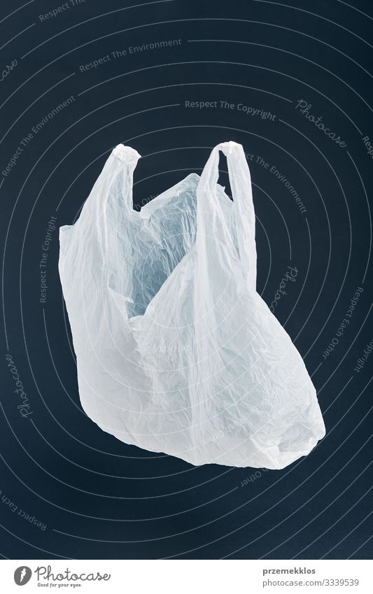 White empty plastic bag floating over black background Black Environment Shopping Plastic Trash Environmental protection Packaging Ecological
