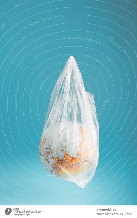 Globe in a plastic bag. Earth contaminated by plastic waste Blue Green Life Environment Copy Space Plastic Sphere Trash Environmental protection Ecological