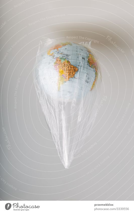 Globe in a plastic bag. Earth contaminated by plastic waste Save Life Environment Plastic packaging Sphere Green Environmental pollution