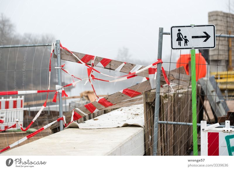 Passage blocked Wall (barrier) Wall (building) Footpath Signs and labeling Signage Warning sign String Town Brown Gray Red White Sidewalk Construction site