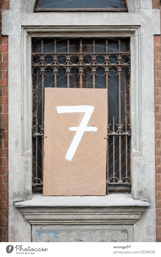 Input number 7 House (Residential Structure) Facade Window Digits and numbers Old Town Brown Gray White Living or residing Grating House number Old building