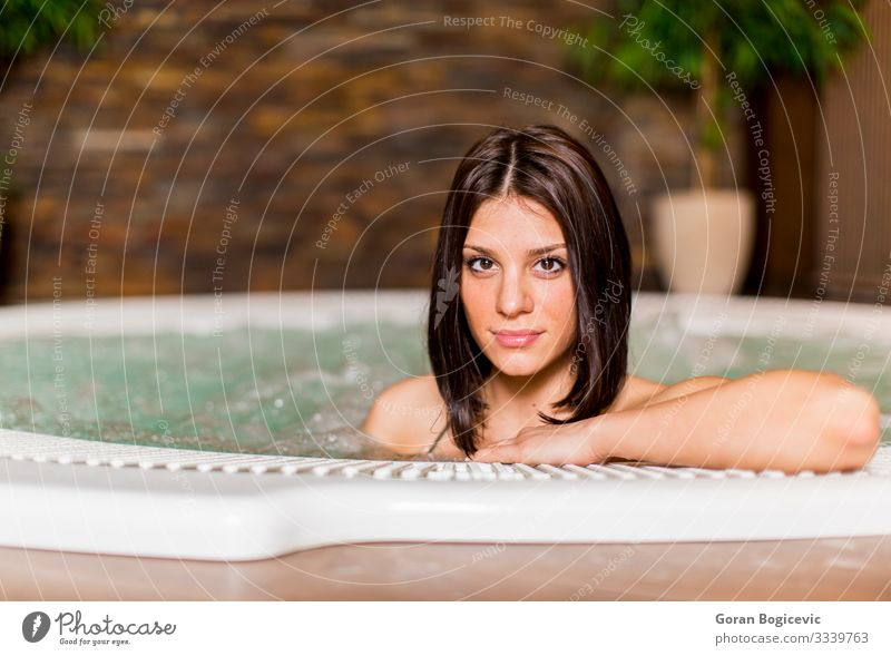 Young woman relaxing in the hot tub Lifestyle Luxury Happy Beautiful Body Face Relaxation Spa Swimming pool Leisure and hobbies Bathroom Human being