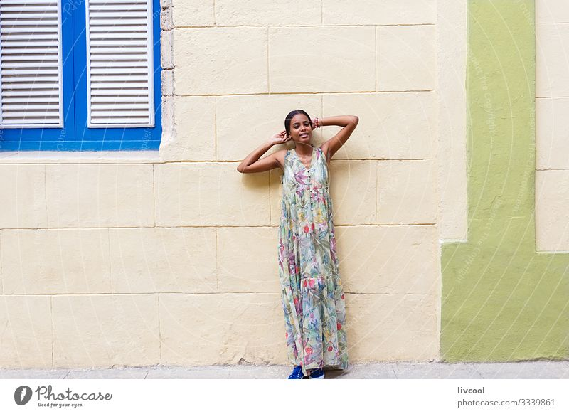 young cuban woman leaning on a wall in havana Lifestyle Happy Island Human being Feminine Young woman Youth (Young adults) Woman Adults Body Skin Head
