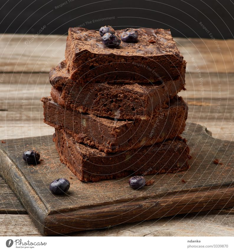 baked slices of brownie chocolate cake Cake Dessert Nutrition Eating Hot Chocolate Table Wood Dark Fresh Delicious Brown Black Tradition cacao Baking Bakery