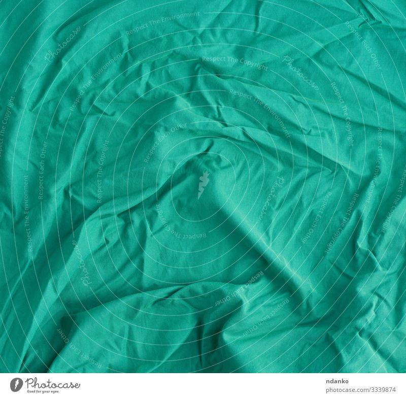 crumpled light green cotton fabric Design Cloth Modern Natural Clean Soft Green Canvas Cotton backdrop background Blank cover creased Effect empty fiber Fold