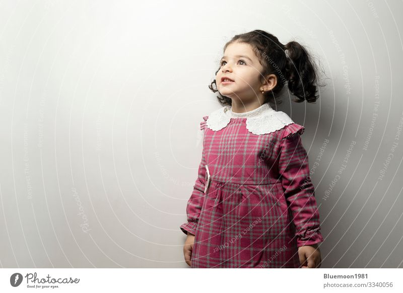 Little girl with side pony hairstyle looking outside of frame center parted hairstyle two years care healthy portrait little girl fashion beauty child children