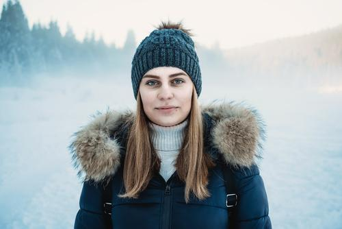 Snow portret of young woman with snow dust in background dof Human being Young woman Youth (Young adults) Body Head 1 18 - 30 years Adults Environment Nature