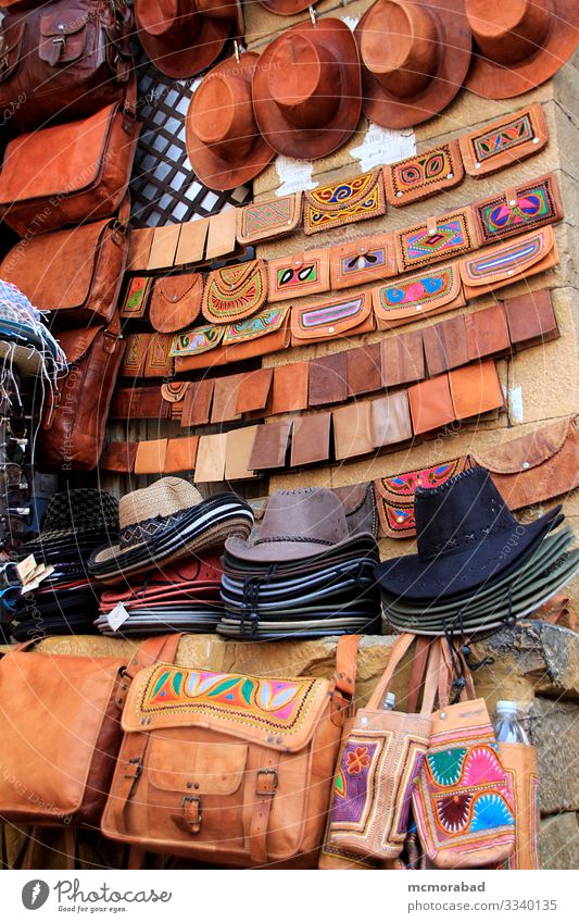 Diplay of Hats and Leather Purses Shopping Handicraft Marketplace Bag Sell Vertical Asia India Rajasthan Jaisalmer Patawon-ki-Haweli market retailing trade Sale