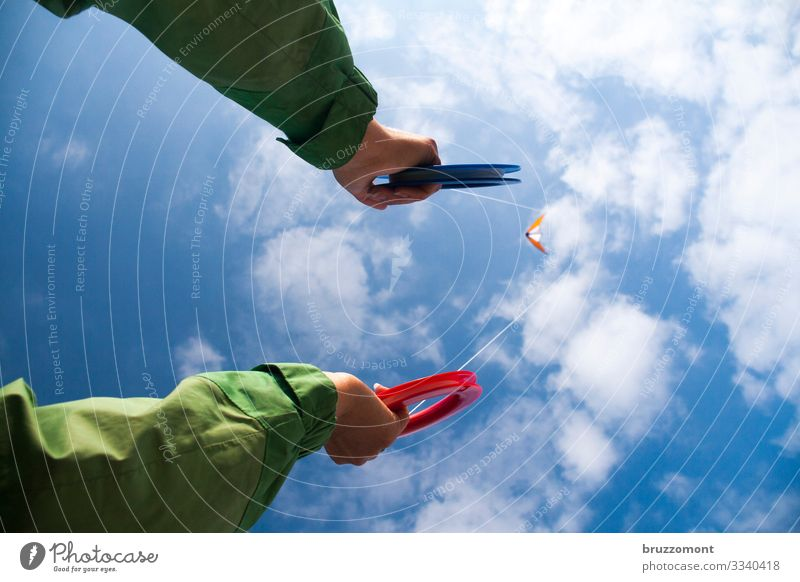kiteflite Leisure and hobbies Human being Life Arm Hand 1 Sky Clouds Beautiful weather Relaxation To hold on Flying Playing Sports Far-off places Tall Athletic