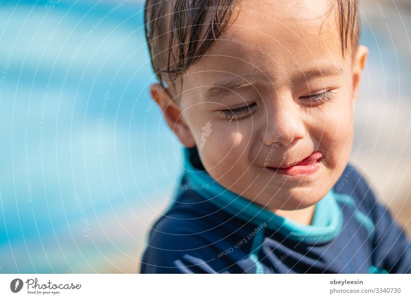 cute young mixed race boy smiling Joy Happy Face Relaxation Swimming pool Leisure and hobbies Playing Vacation & Travel Summer Sports Success Child Human being