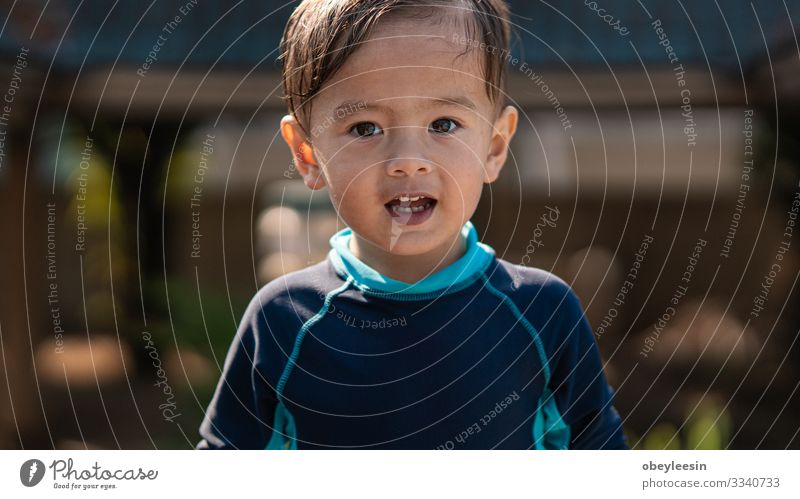 cute young mixed race boy smiling in the sun Joy Happy Face Relaxation Swimming pool Leisure and hobbies Playing Vacation & Travel Summer Sports Success Child