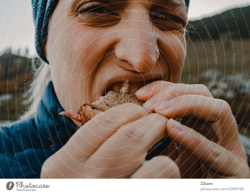 eat sausage bread Hiking Eating snack Sausage sandwich Bread Bite In transit food and drink hunger hands Looking bite off Nature Landscape Sports Nutrition