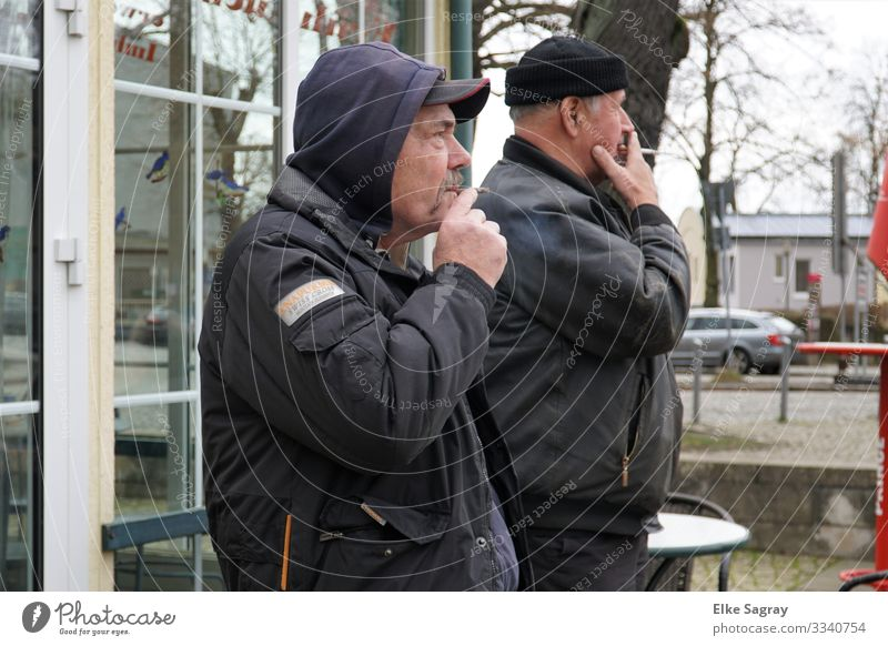 Synchronous Smoker Human being Masculine Male senior Man 2 60 years and older Senior citizen Observe Relaxation Smoking Looking Stand Authentic Original Blue
