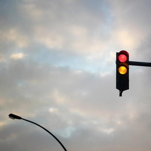 ready steady | interfaces of everyday life (10) Traffic light Red Yellow Sky Lamp streetlamp Storm clouds Road sign Signal embassy Information Transport