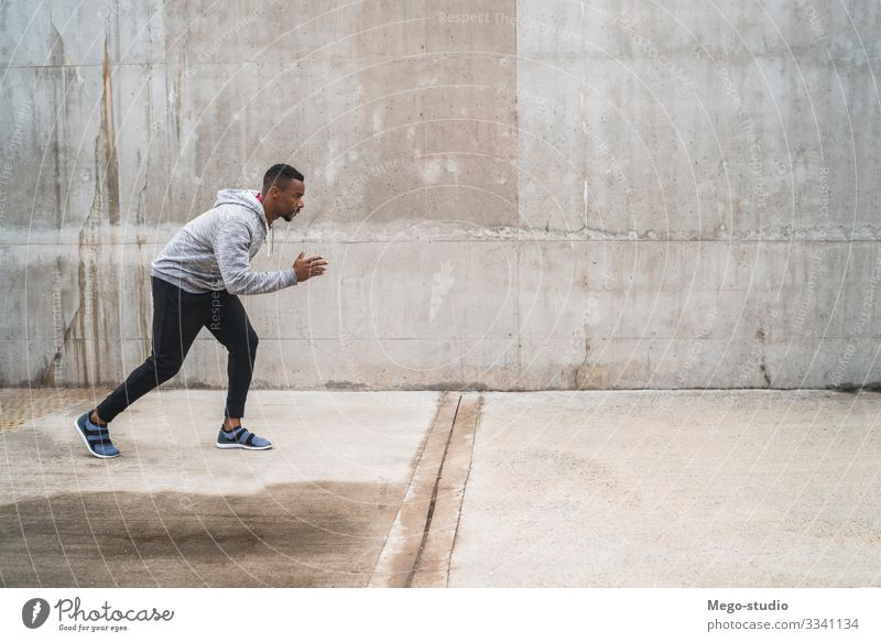Portrait of an athletic man running. Lifestyle Personal hygiene Body Relaxation Leisure and hobbies Sports Fitness Sports Training Jogging Human being Masculine