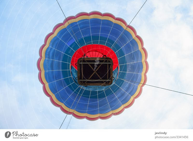 Captive balloon in Aeroestacion Festival in Guadix Joy Relaxation Leisure and hobbies Vacation & Travel Adventure Sky Clouds Transport Balloon Hot Blue Yellow