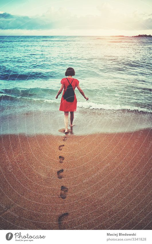 Woman walks toward the sea at sunset, Lifestyle Relaxation Leisure and hobbies Vacation & Travel Tourism Trip Adventure Freedom Summer Summer vacation Sun Beach