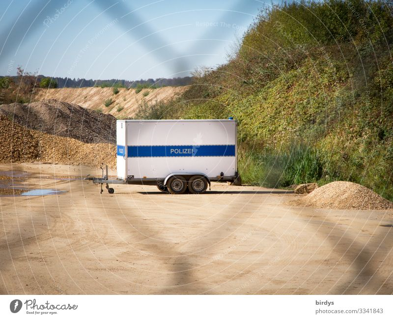 classified information Police Force Landscape Sand Cloudless sky Summer Beautiful weather Gravel pit Gravel plant Trailer Wire netting fence Characters Wait