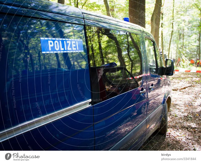 Blue in green Nature Summer Climate change Beautiful weather Tree Forest Truck Police car Fire engine Police Force Barrier police deployment Characters
