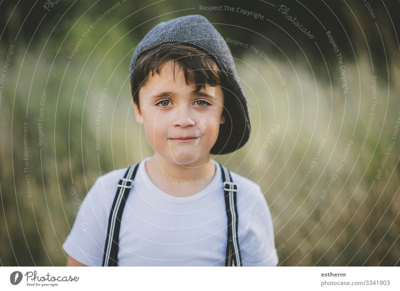 happy child smiling at camera Child Human being Vacation & Travel Nature Summer Green Landscape Joy Lifestyle Love Emotions Laughter Happy Grass Boy (child)