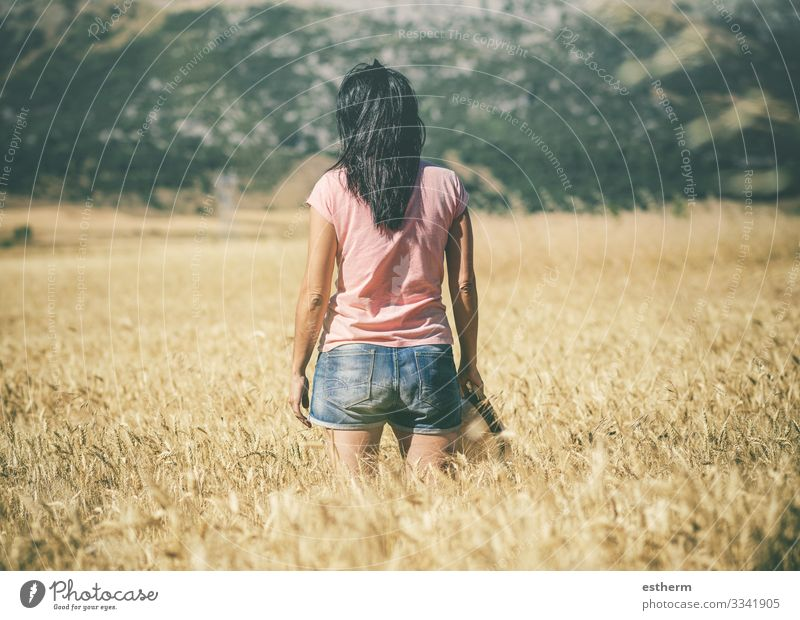 Thoughtful young woman in the wheat field Lifestyle Relaxation Leisure and hobbies Vacation & Travel Tourism Trip Freedom Summer Mountain Human being Feminine