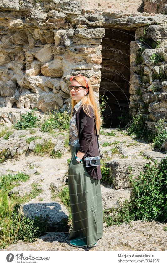 Young female traveler visiting ancient ruins in Tuscany Lifestyle Vacation & Travel Tourism Trip Sightseeing Human being Feminine Young woman