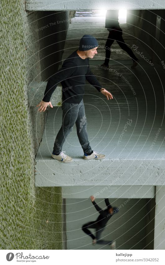 Man standing at a wall Human being Masculine Adults 1 45 - 60 years Town House (Residential Structure) Facade Gray Going doubleganger Parkour Illusion Rotated