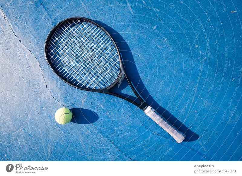 yellow tennis ball on the floor of the tennis court with racket Lifestyle Joy Playing Summer Sports Human being Man Adults Friendship Partner Fitness Green
