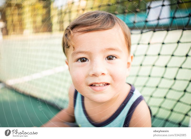 cute young mixed race boy smiling in the sun on the court Joy Happy Beautiful Face Child Human being Toddler Boy (child) Man Adults Infancy Teeth Smiling