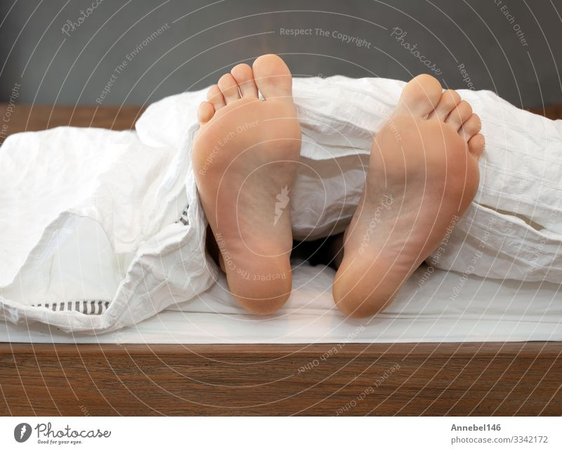 One pair of Feet alone in Bed on White Sheets Skin Relaxation Child School Human being Boy (child) Man Adults Sleep Comfortable Colour bed blanket Barefoot