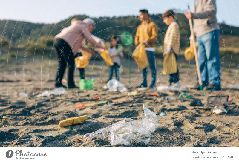 Plastics in the beach with group of volunteers Beach Child Human being Boy (child) Woman Adults Man Group Environment Sand Gloves Old Dirty Clean