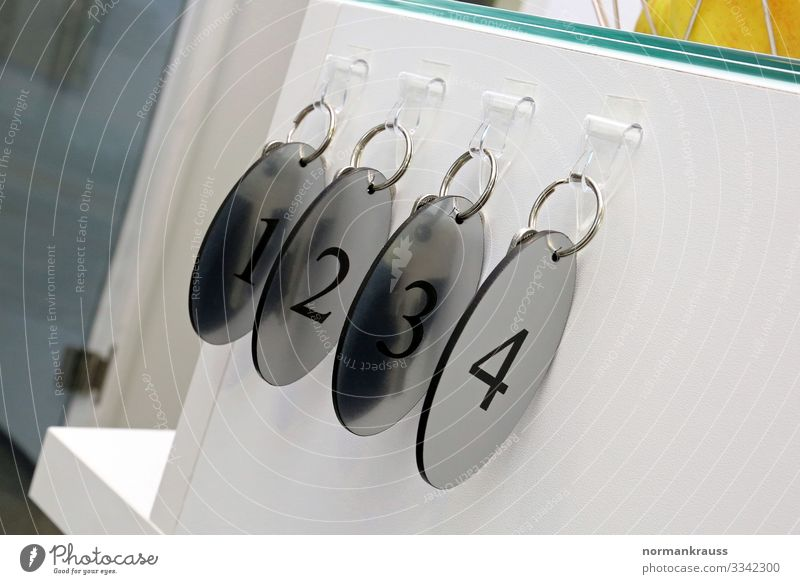 Keychain, one, two, three, four Keyring 1 2 3 4 Digits and numbers Glittering Near Round Silver Safety Colour photo Subdued colour Interior shot Close-up Detail