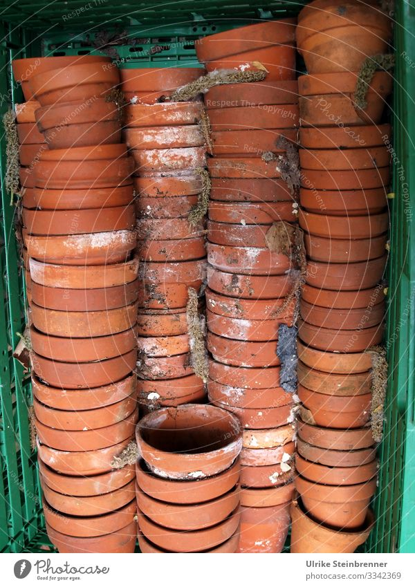 Discarded terracotta flower pots in stacks Flowerpot plant pot Terracotta shards Old Second-hand stacked Stack Crate quantity Winter activities clay pots