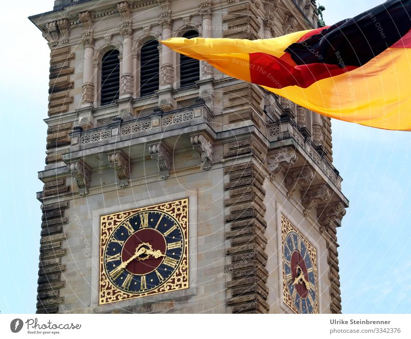 Clock at Hamburg City Hall with German flag Tourism Trip Sightseeing City trip Germany Europe Port City Downtown City hall Tower Manmade structures built