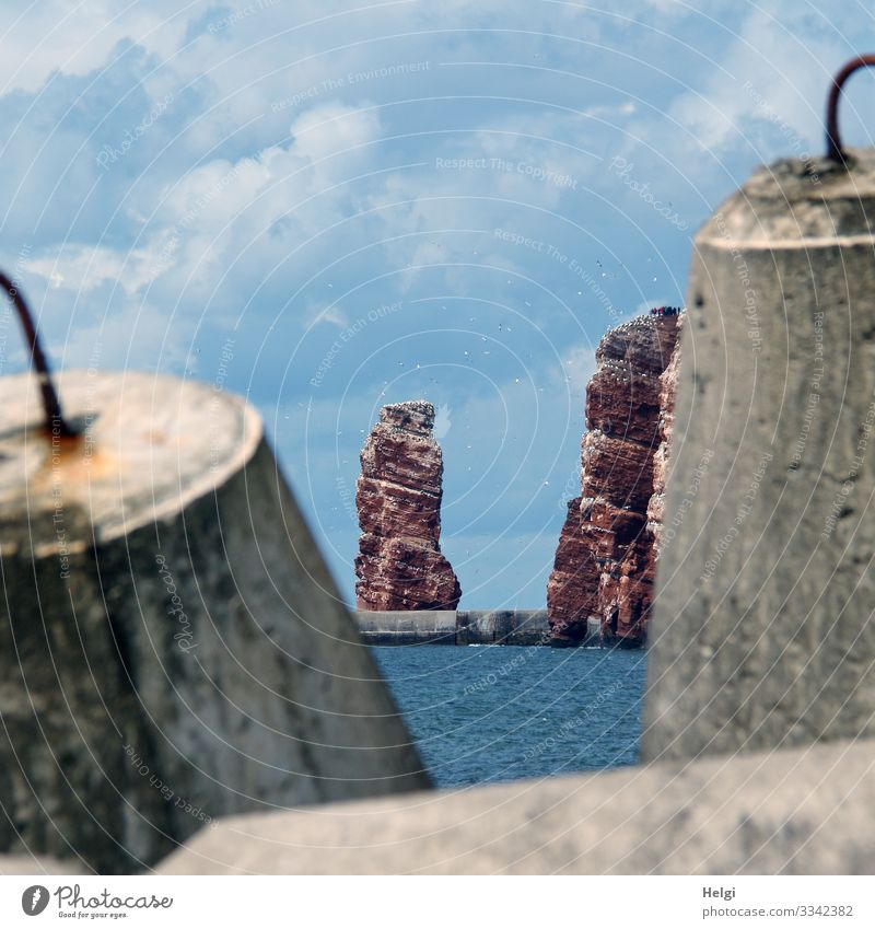 """through concrete breakwaters you can look at the """"Lange Anna"""" and the red rocks of Helgoland Vacation & Travel Tourism Ocean Environment Nature Landscape Water"""
