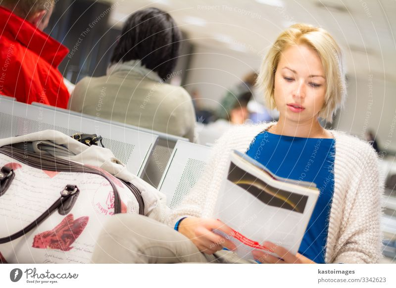 Woman reading a magazine while waiting. Human being Vacation & Travel Beautiful Adults Tourism Trip Leisure and hobbies Transport Aviation Sit Wait Reading