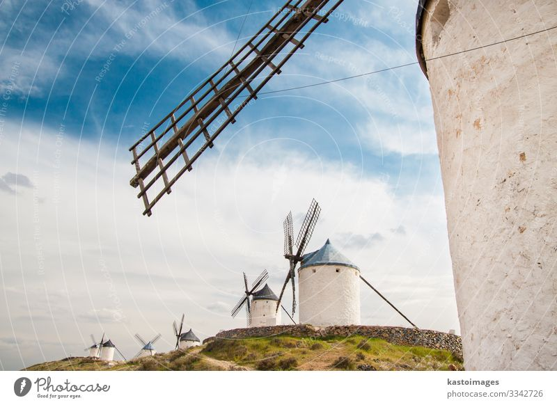 Vintage windmills in La Mancha. Vacation & Travel Tourism Summer Mountain House (Residential Structure) Culture Environment Nature Landscape Plant Clouds Wind