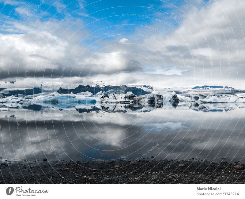 Jokulsarlon ice lake in Iceland Environment Nature Landscape Elements Earth Sand Water Clouds Summer Winter Beautiful weather Frost Snow Glacier Lakeside