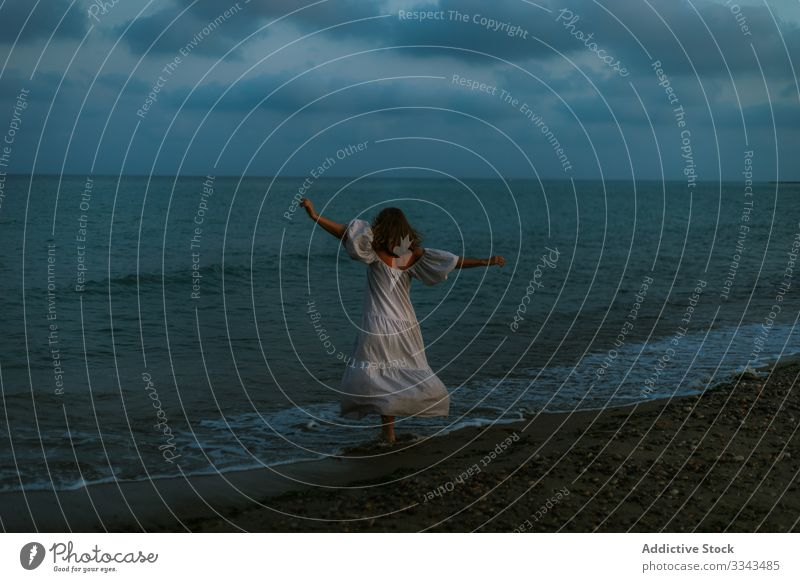 Female tourist seaside woman beach waves barefoot seashore sky heaven dusk clouds female lady walking coastline empty lonely blue dress beautiful vacation water