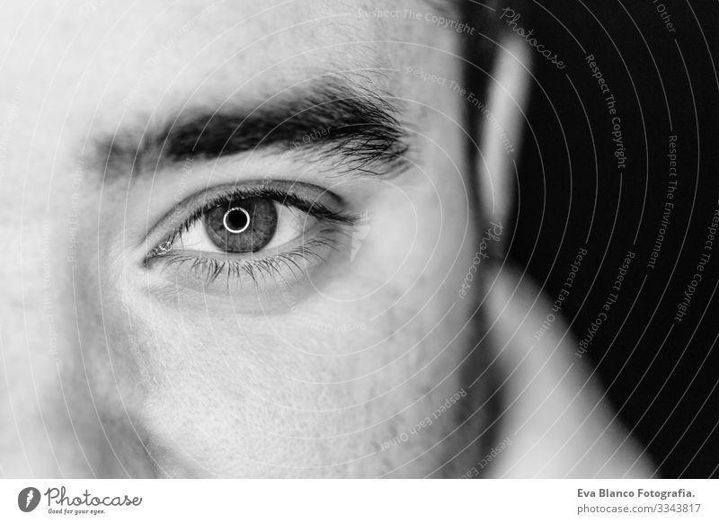 close up half side portrait of a young man. studio shot. led ring reflection in the eyes Head White Human being Man Black Dramatic Lifestyle Close-up 1