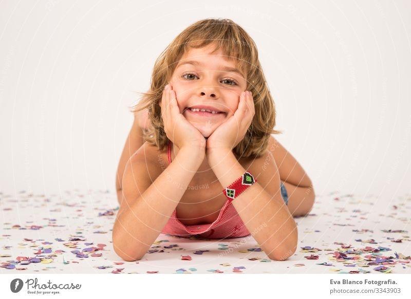 little girl portrait. indoors, confetti on the floor. white background Portrait photograph Joy Child Cute lifestyle happiness Cheerful Beautiful Small Hair