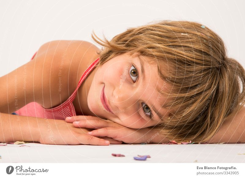 kid having fun on the floor close up portrait, white background Portrait photograph Joy Child Cute lifestyle happiness Cheerful Beautiful Small Hair