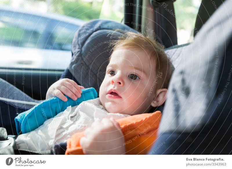 cute baby blonde girl, in car seat wearing seat belts happy is going to go in the path of the road. Spring or summer season Belt Summer Small Child Contentment