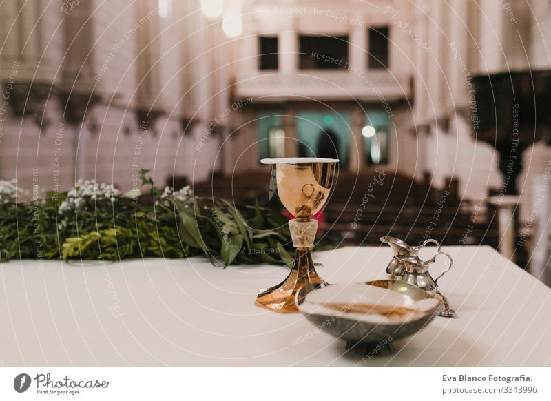 goblet of wine on table during a wedding ceremony nuptial mass. Religion concept. Catholic eucharist ornaments for the celebration of the Eucharist Open Holy