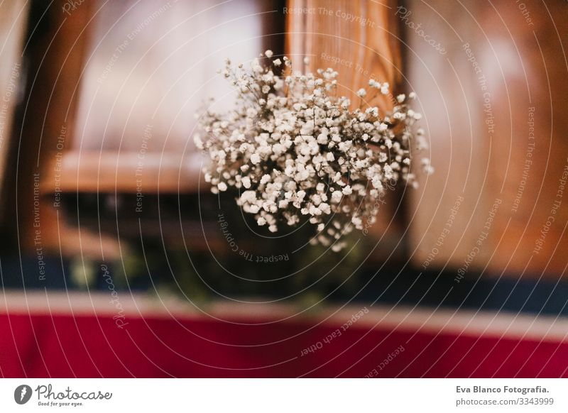 Beautiful flower wedding decoration in a church. Selective focus. Marriage concept in church bunch Groom White Colour Elegant Wedding Day Fresh Rose commitment