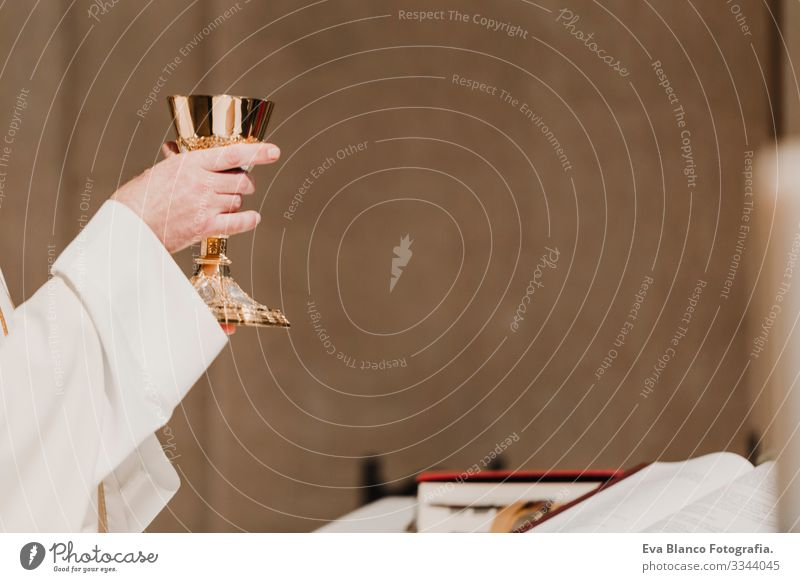 unrecognizable Priest holding the goblet during a wedding ceremony nuptial mass. Religion concept jesus Ritual Protestant Modern divine Cup eucharist Goblet