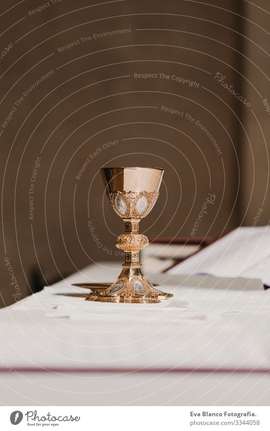 goblet of wine on table during a wedding ceremony nuptial mass. Religion concept jesus Ritual Protestant Modern divine Cup eucharist Goblet Christianity rite