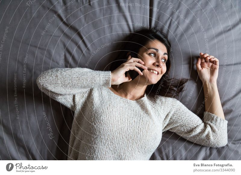 young woman speaking on the phone on bed Youth (Young adults) Woman Coffee Lifestyle Easygoing Internet Business Interlaced Selfie Social Bed