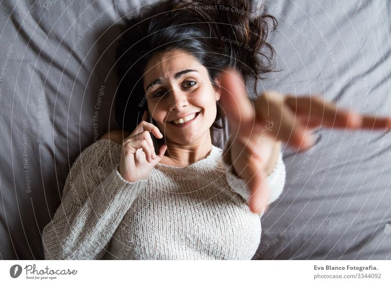 young woman speaking on the phone and smiling Youth (Young adults) Woman Coffee Lifestyle Easygoing Internet Business Interlaced Selfie Social Bed